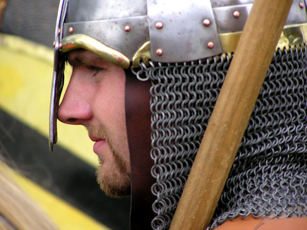Military History - Norman Warrior's helmet with nose protection and chain mail carrying spear